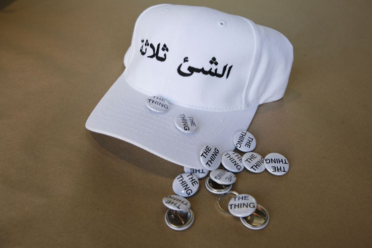 White baseball cap with black stitching